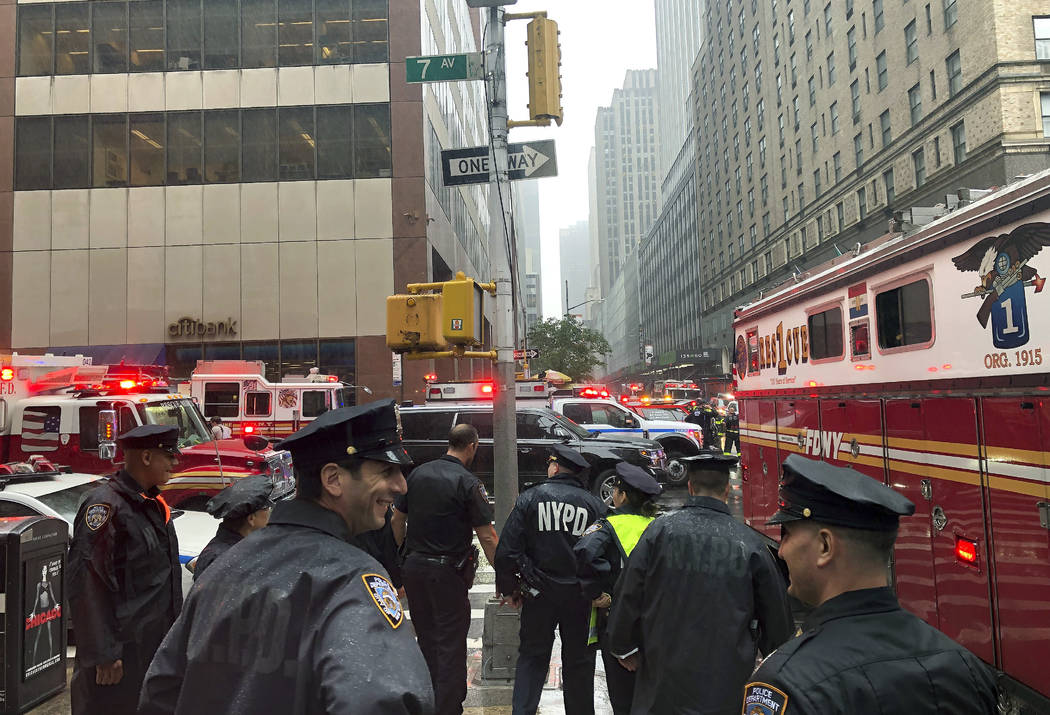 New York police officers monitor the streets near 51st Street and 7th Avenue, Monday, June 10, ...