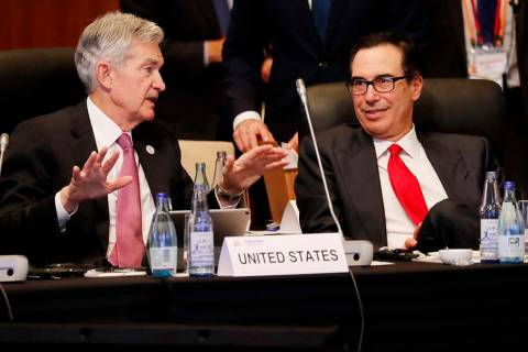Federal Reserve Chairman Jerome Powell talks with U.S. Treasury Secretary Steven Mnuchin during ...