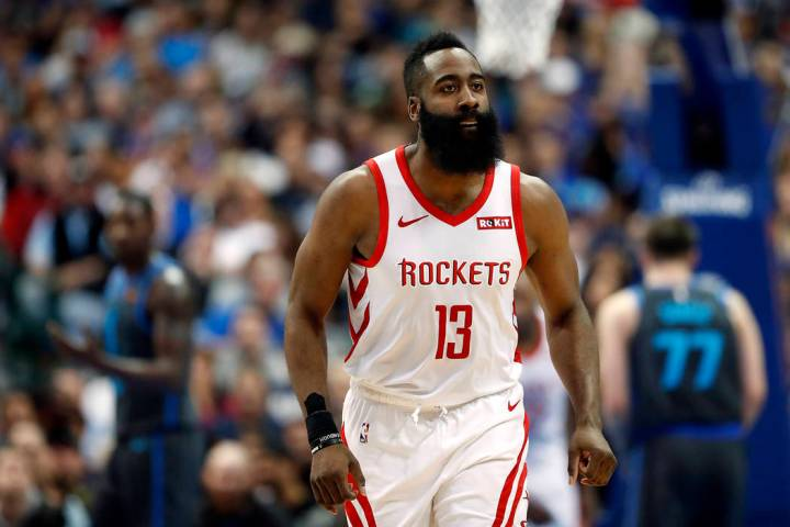 Houston Rockets' James Harden looks at his bench during an NBA basketball game against the Dall ...
