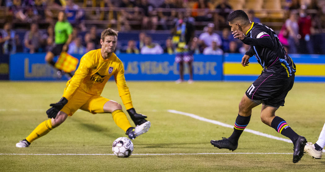 Las Vegas Lights FC forward Irvin Parra (11, right) sends a shot towards the net past Orange Co ...