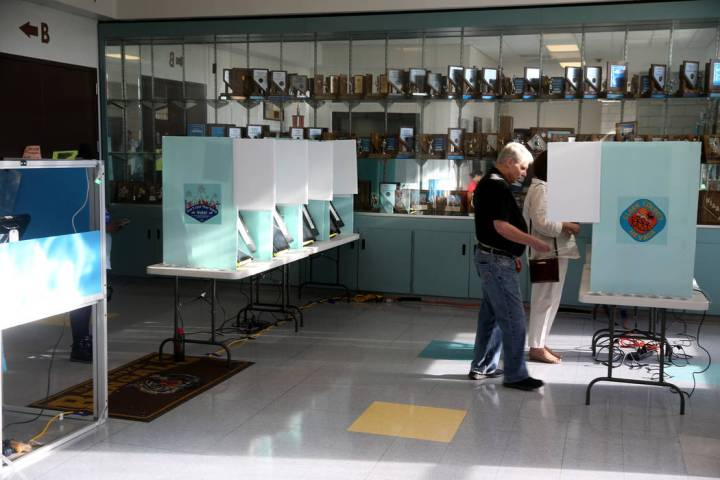 Andy and Terry Plourd of Las Vegas vote in the municipal election at Bonanza High School in Las ...