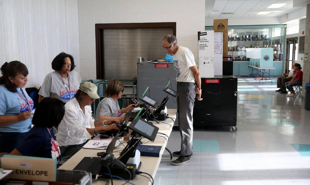 Kim Een of Las Vegas checks in to vote in the municipal election at Bonanza High School in Las ...