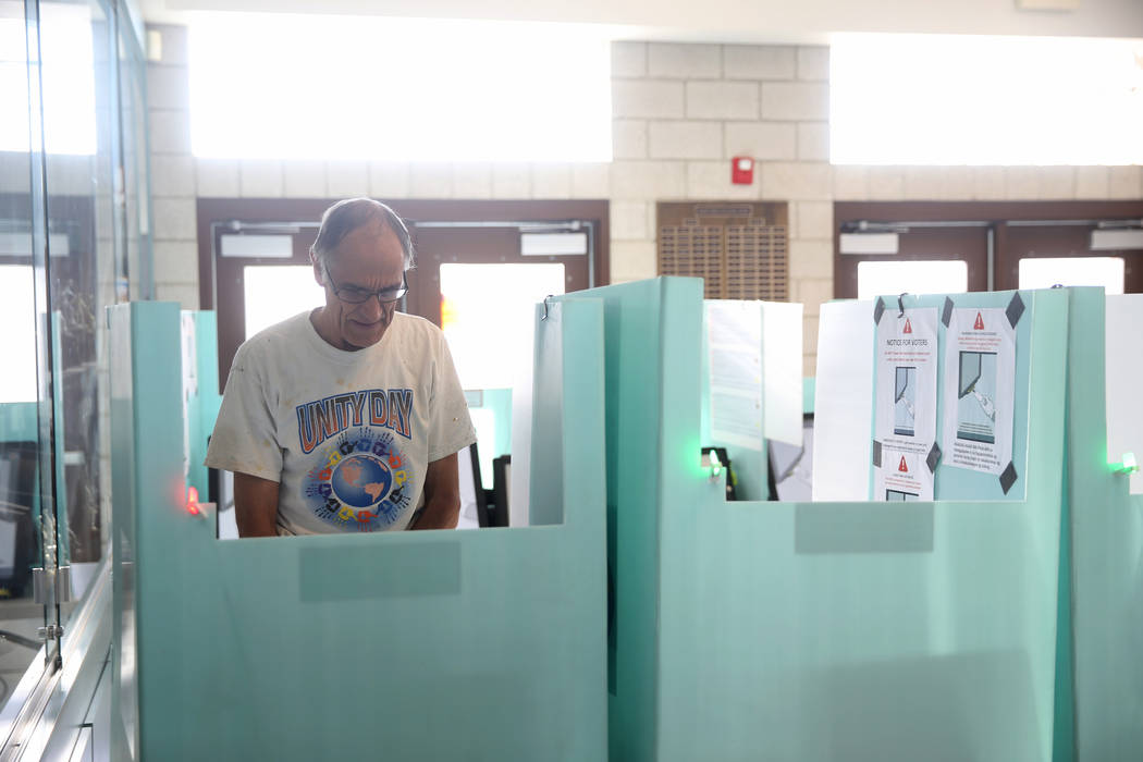 Kim Een of Las Vegas votes in the municipal election at Bonanza High School in Las Vegas, Tuesd ...