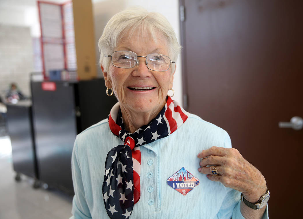 "Janice Jacobsen of Las Vegas dons her ""I VOTED"" sticker after voting in the municipal election ..."