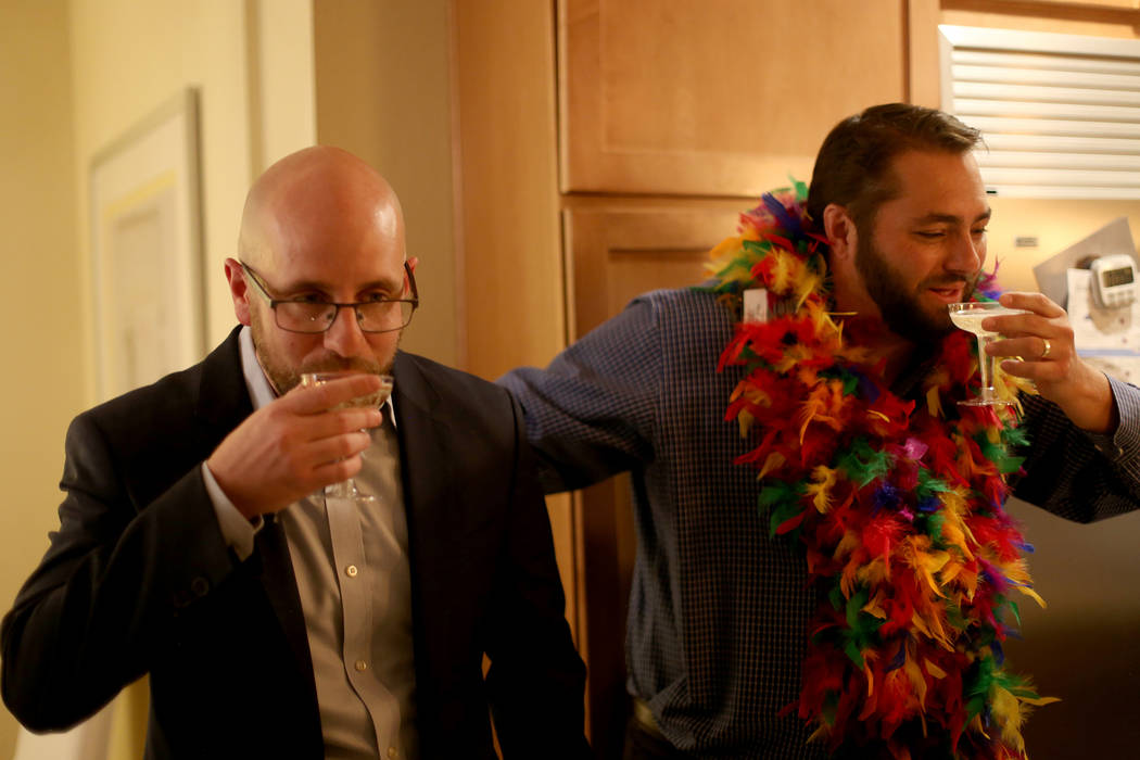 Brian Knudsen, left, winner of the Las Vegas City Council seat for Ward 1, toasts with campaign ...