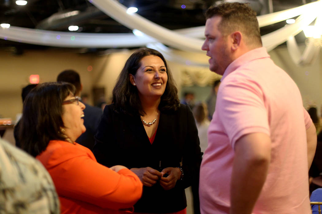 Former Assemblywoman Olivia Diaz speaks to supporters Jared Oscarson, right, and Irene Bustaman ...