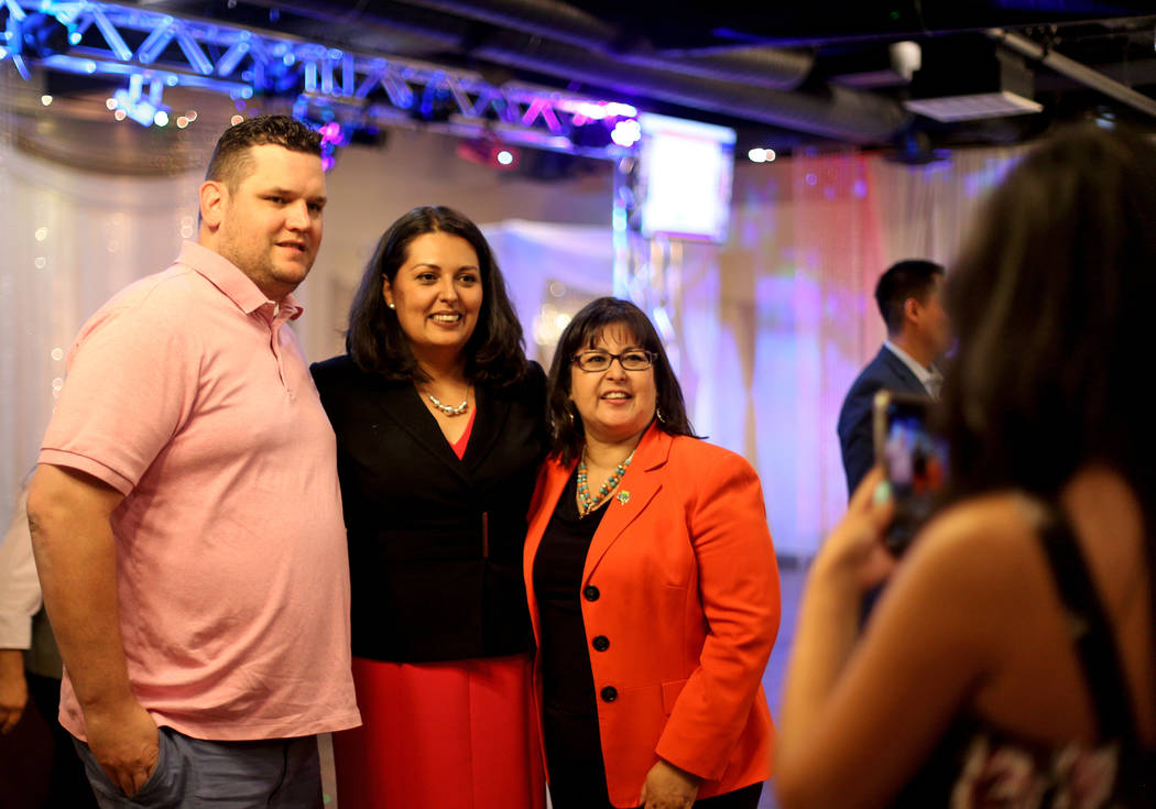 Former Assemblywoman Olivia Diaz takes a photo with supporters Jared Oscarson, left, and Irene ...