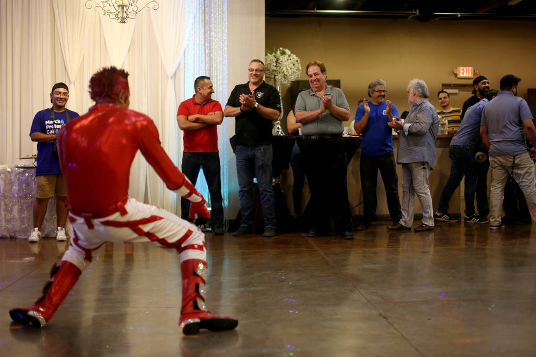 Jimmy Gonzales, a mannequin dancer, performs at an election night viewing party for former Asse ...