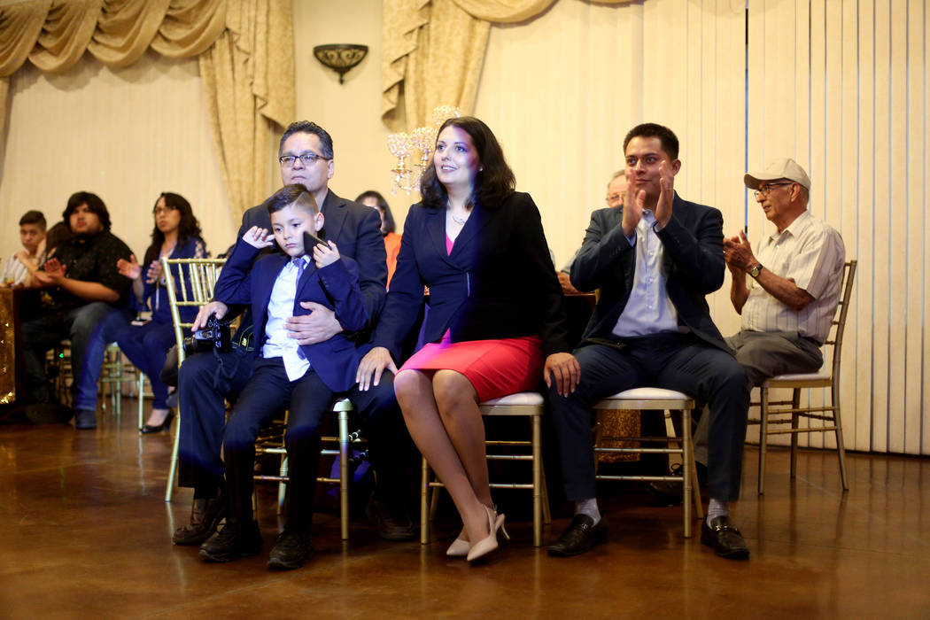 Former Assemblywoman Olivia Diaz sits with her husband Frank Alejandre, left, and their son Xav ...