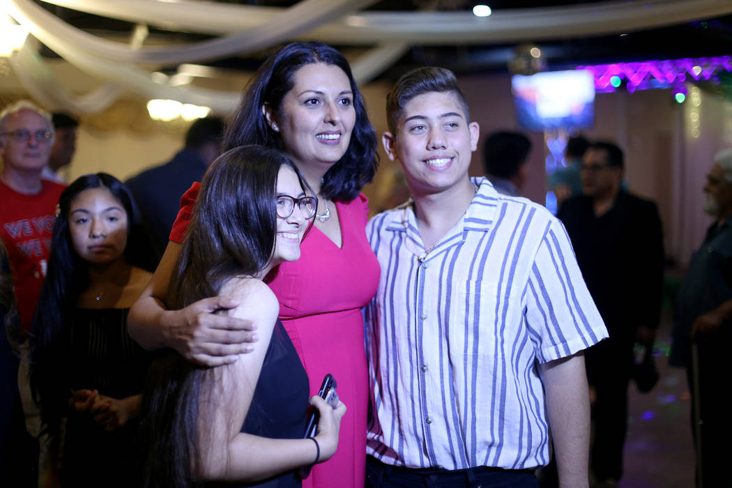 Former Assemblywoman Olivia Diaz takes a photo with Jamie Martinez, 16, left, and Griffin Morri ...