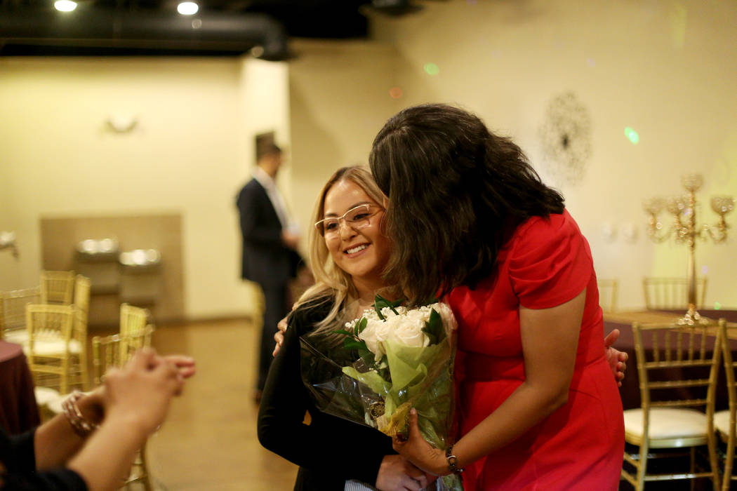 Former Assemblywoman Olivia Diaz greets Mary Ramirez after receiving flowers from her after win ...