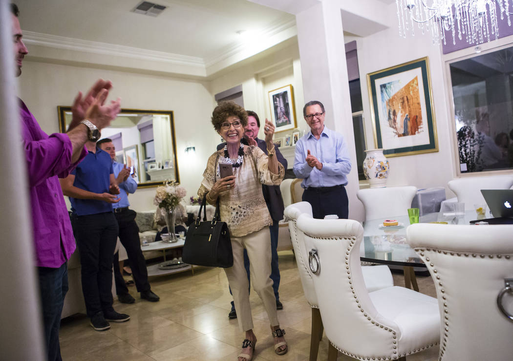 Evelyn Cannestra, center, celebrates as voting results are updated, projecting Las Vegas City C ...