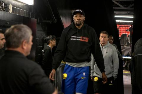 Golden State Warriors NBA basketball player Kevin Durant leaves the court after a closed practi ...