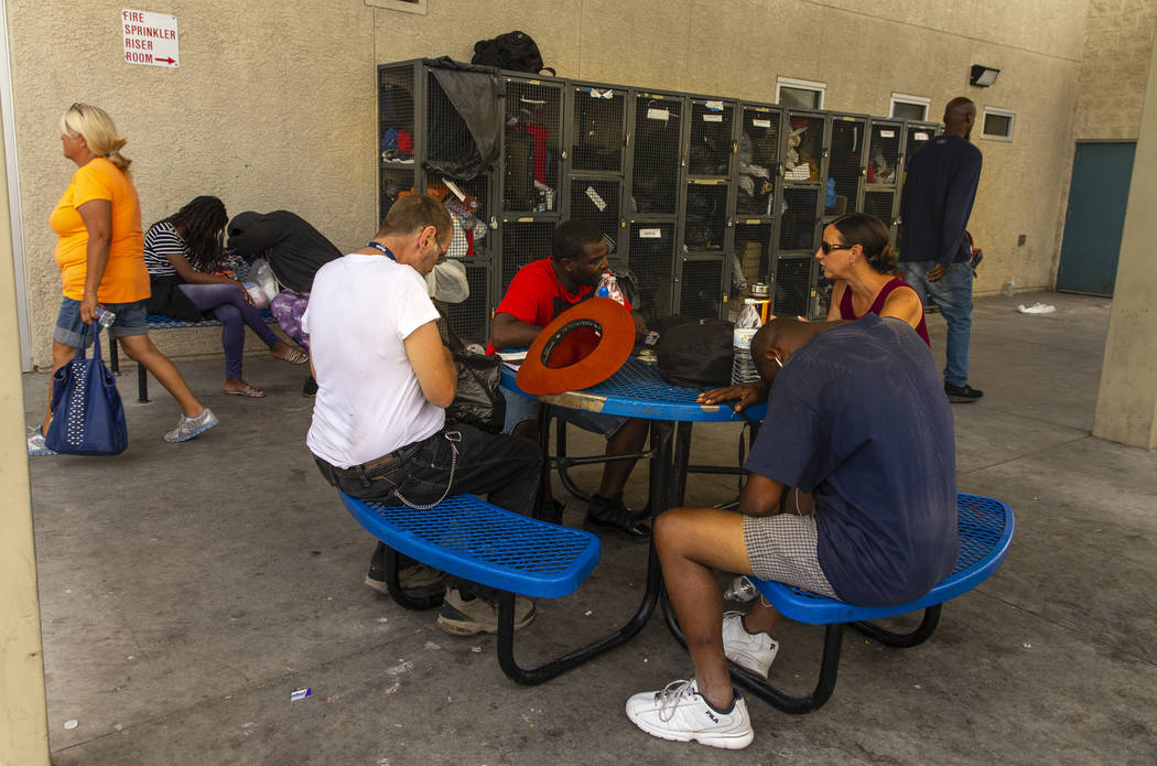 Clients and workers use the courtyard at The Salvation Army which offers a summer day shelter o ...