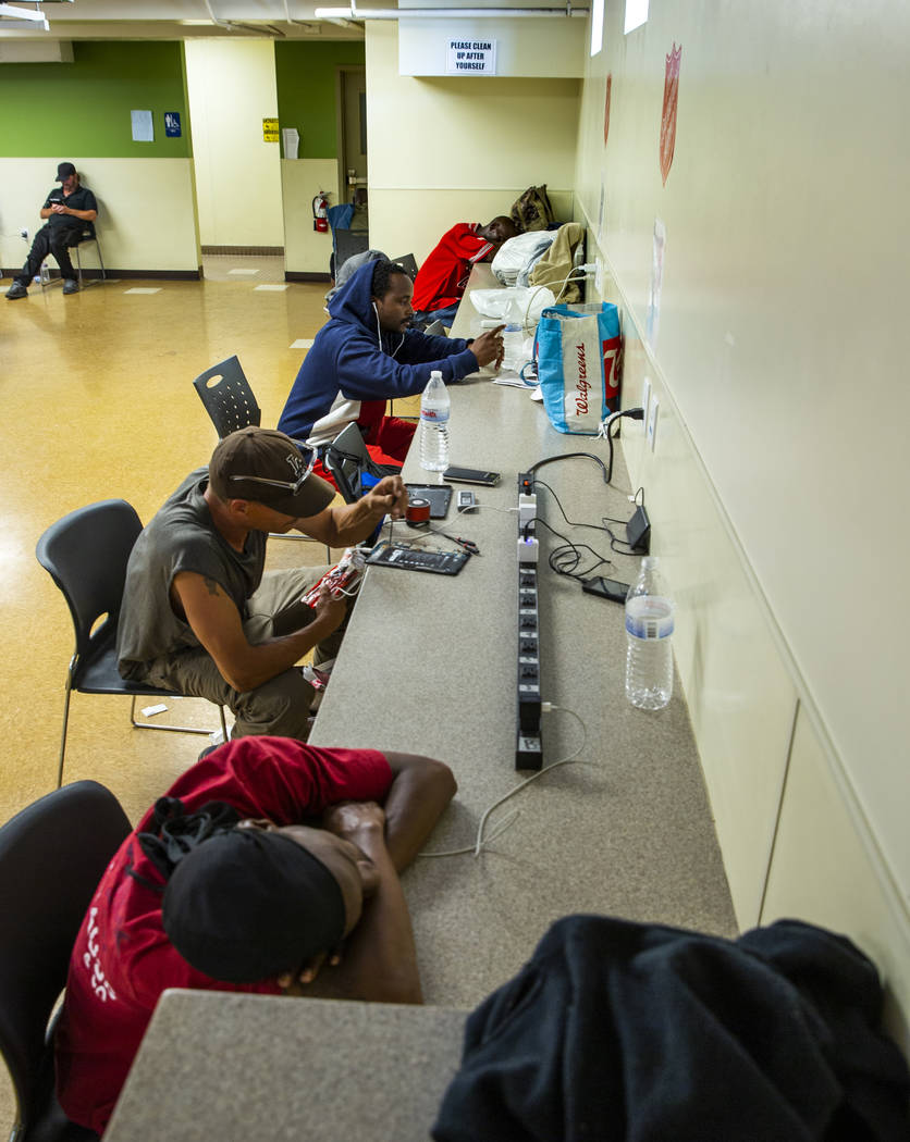 Clients charge their electronics in the day room at The Salvation Army which offers a summer da ...