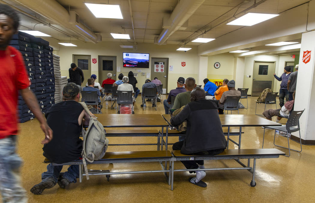Clients relax in the day room at The Salvation Army which offers a summer day shelter opened fo ...