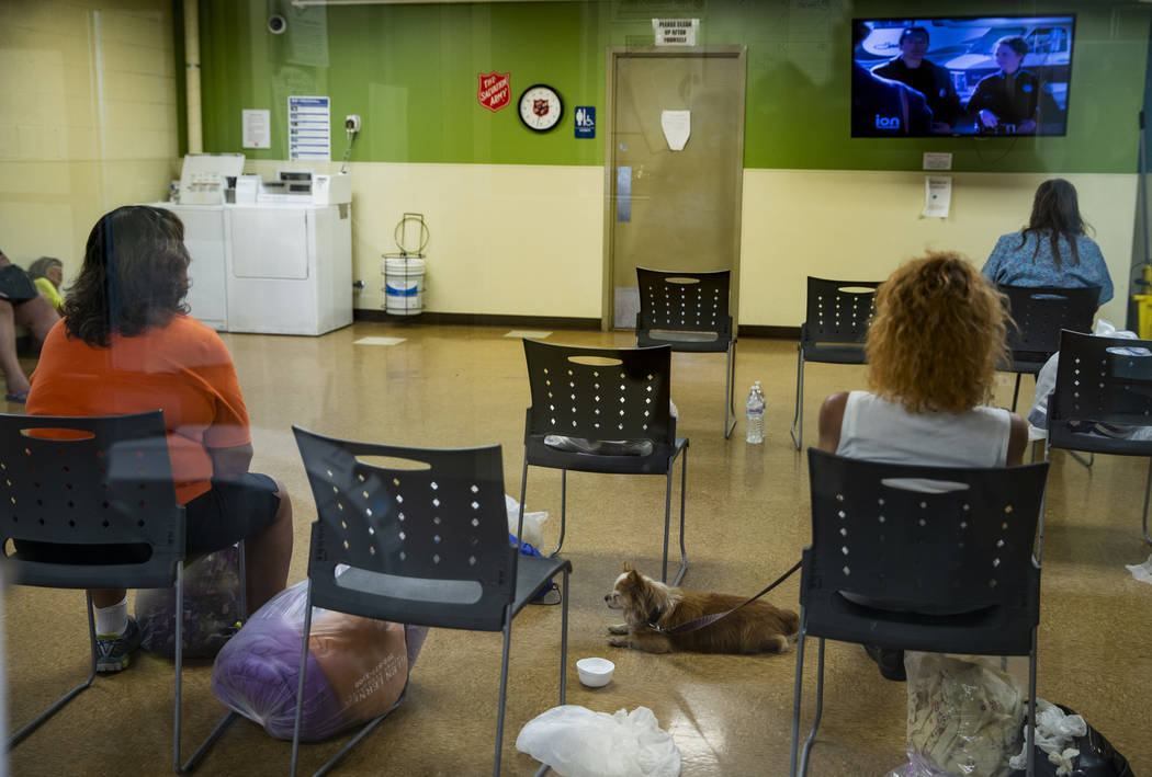 Clients relax in the day room and wash clothes at The Salvation Army which offers a summer day ...