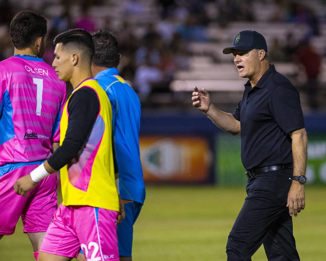 Las Vegas Lights FC goalkeeper Thomas Olsen (1) looks back and listens to head coach Eric Wynal ...