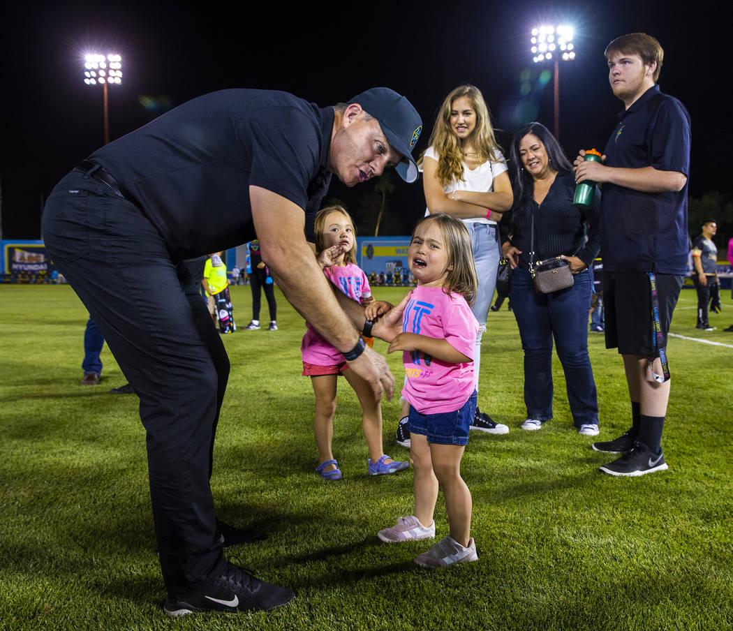 Las Vegas Lights FC coach Eric Wynalda comforts his daughter Elliotte, 3, following the game ve ...