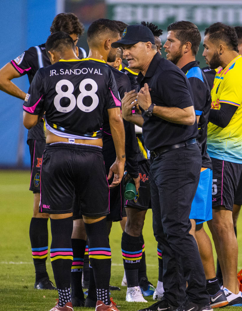 Las Vegas Lights FC forward Junior Sandoval (88) is counseled by head coach Eric Wynalda during ...