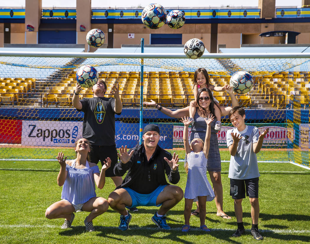 Las Vegas Lights FC coach Eric Wynalda and his family come together following practice at Cashm ...