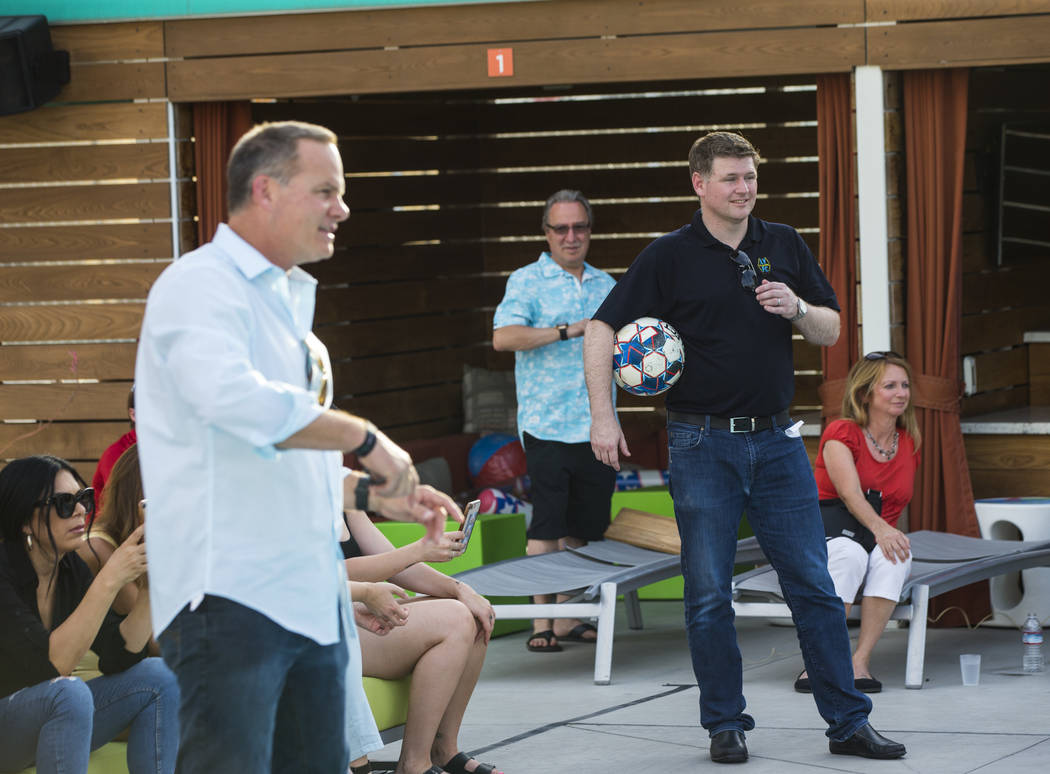 Brett Lashbrook, owner and CEO of Lights FC, right, looks on during preparations for the team's ...