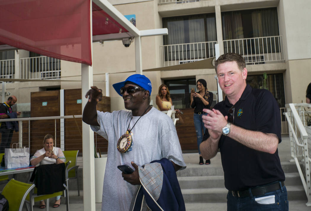 Brett Lashbrook, owner and CEO of Lights FC, right, introduces entertainer Flavor Flav, left, a ...