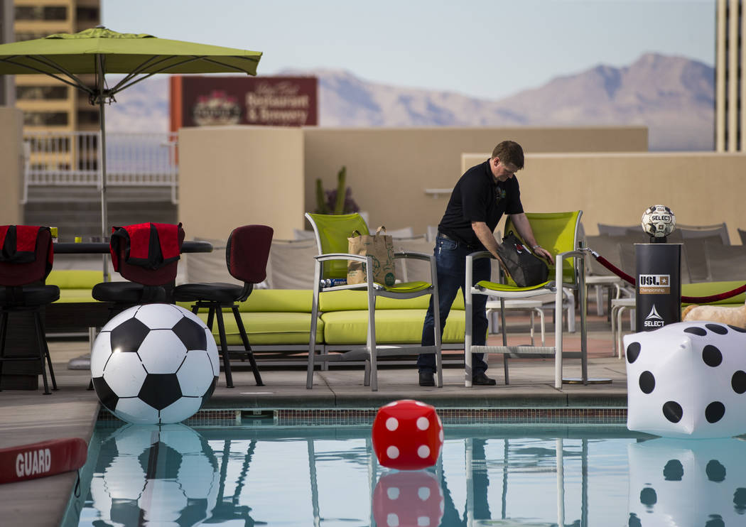 Brett Lashbrook, owner and CEO of Lights FC, helps prepare ahead of the team's photo shoot at t ...