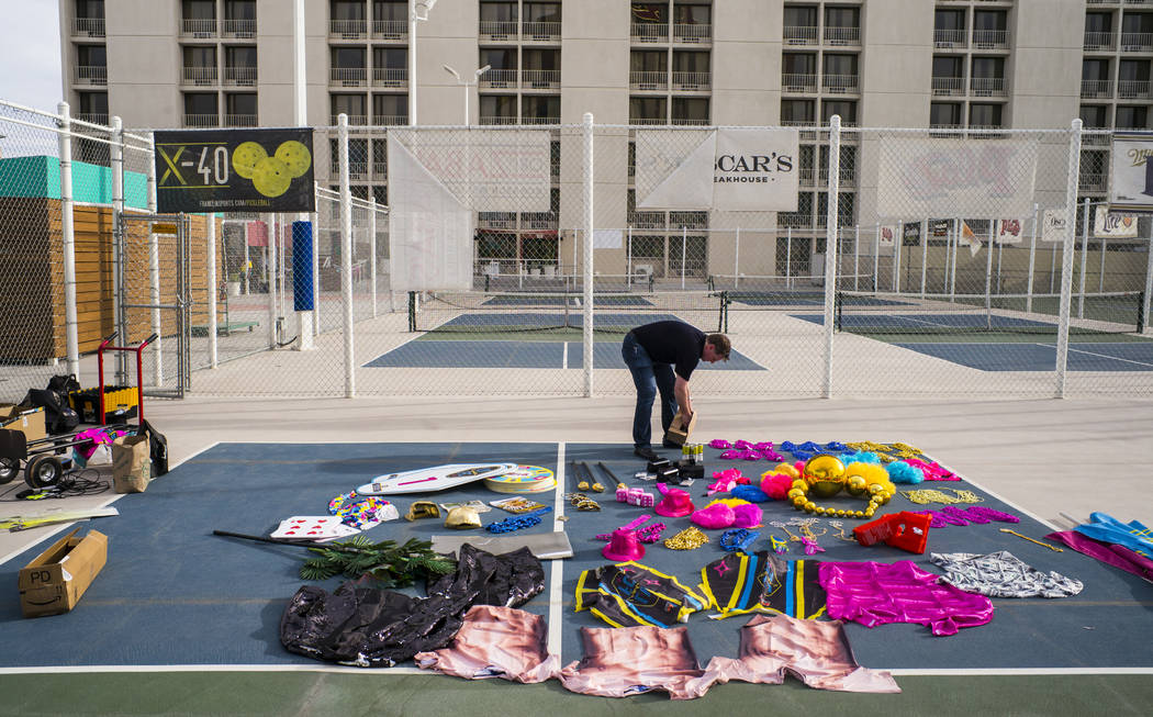Brett Lashbrook, owner and CEO of Lights FC, right, looks through props while setting up for th ...