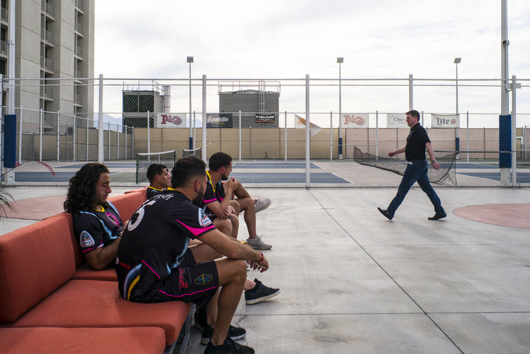 Brett Lashbrook, owner and CEO of Lights FC, right, walks past players as he helps set up for t ...