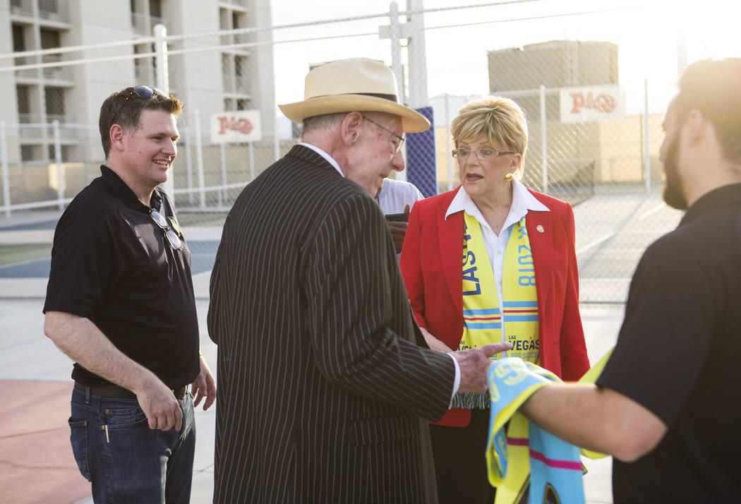 Brett Lashbrook, owner and CEO of Lights FC, left, talks with Mayor Carolyn Goodman, center rig ...