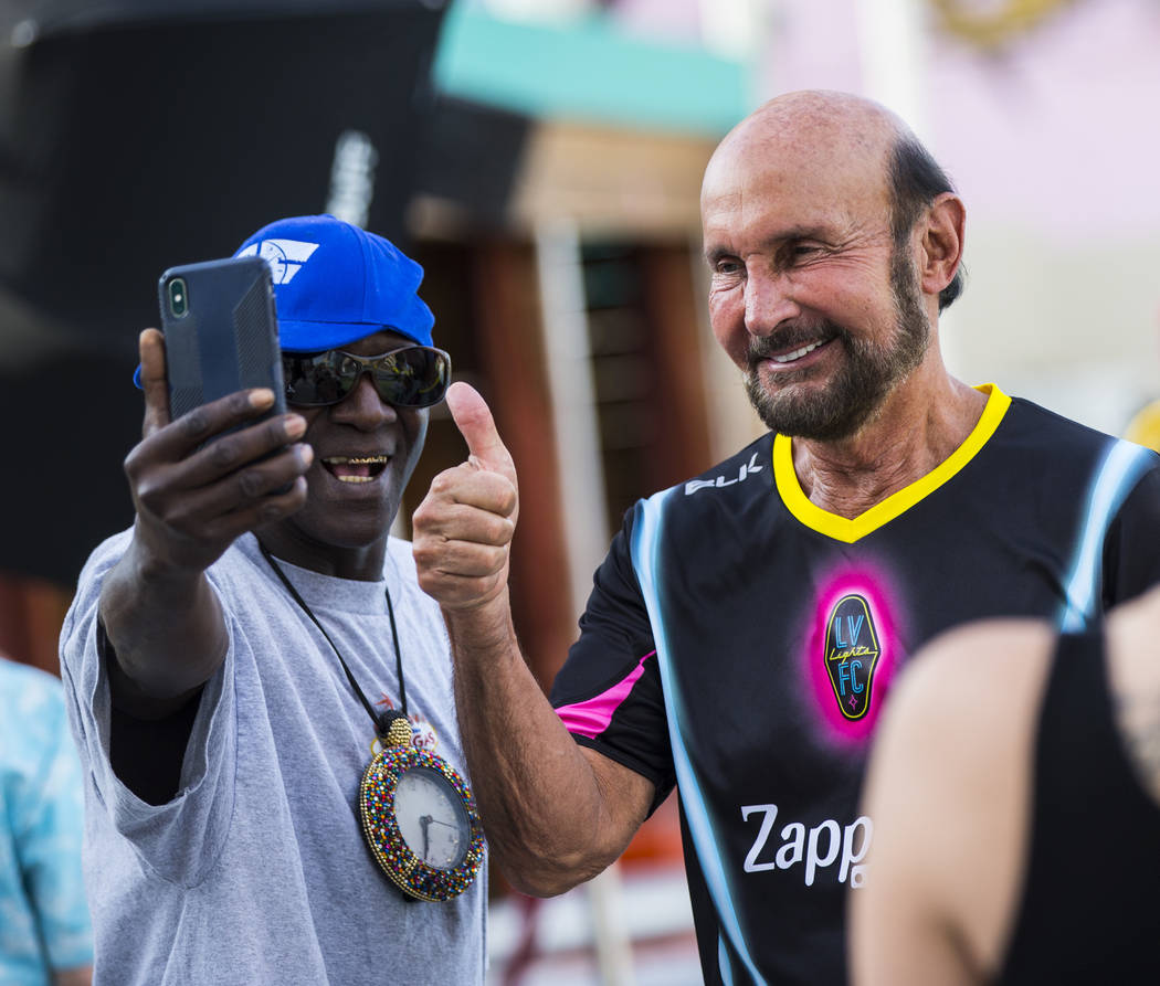 Entertainer Flavor Flav, left, records video with attorney Ed Bernstein ahead of the Lights FC ...