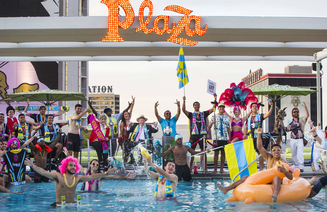 Players and special guests pose for the Lights FC team photo shoot at the Plaza in Las Vegas on ...