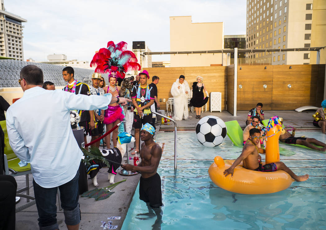 Lights FC players and others prepare for the team's photo shoot at the Plaza in Las Vegas on Tu ...