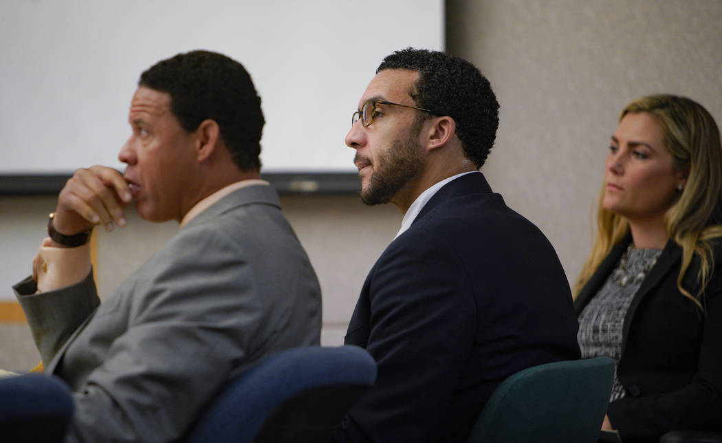 Sitting in Superior Court in Vista, Kellen Winslow, Jr., is flanked by two of his three defense ...