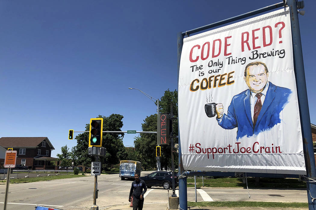 A sign supporting Springfield meteorologist Joe Crain appears at Grab a Java, a drive-through c ...