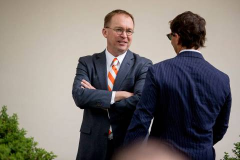 President Donald Trump's Chief of Staff Mick Mulvaney, left, speaks with Deputy White House pre ...