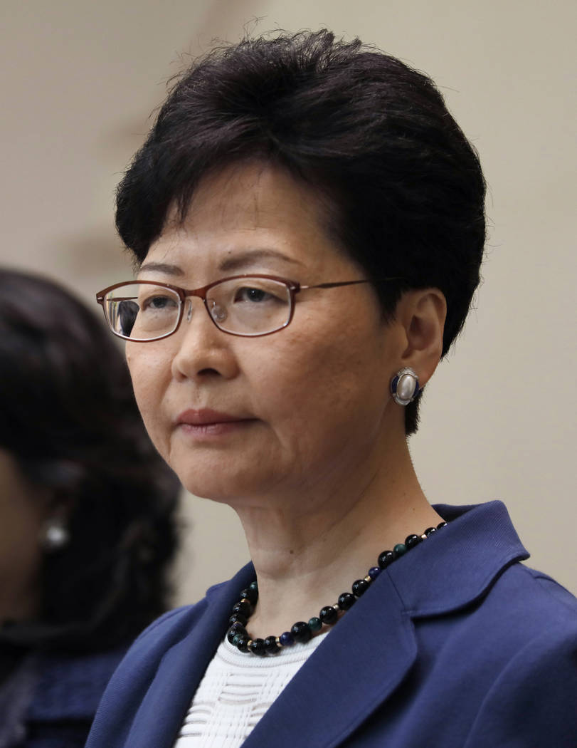 Hong Kong Chief Executive Carrie Lam listens to reporters questions during a press conference i ...