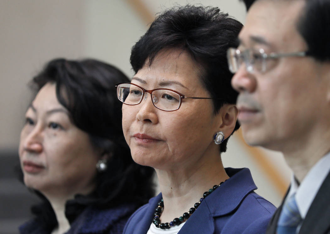 From right, Hong Kong Secretary for Security John Lee, Hong Kong Chief Executive Carrie Lam and ...