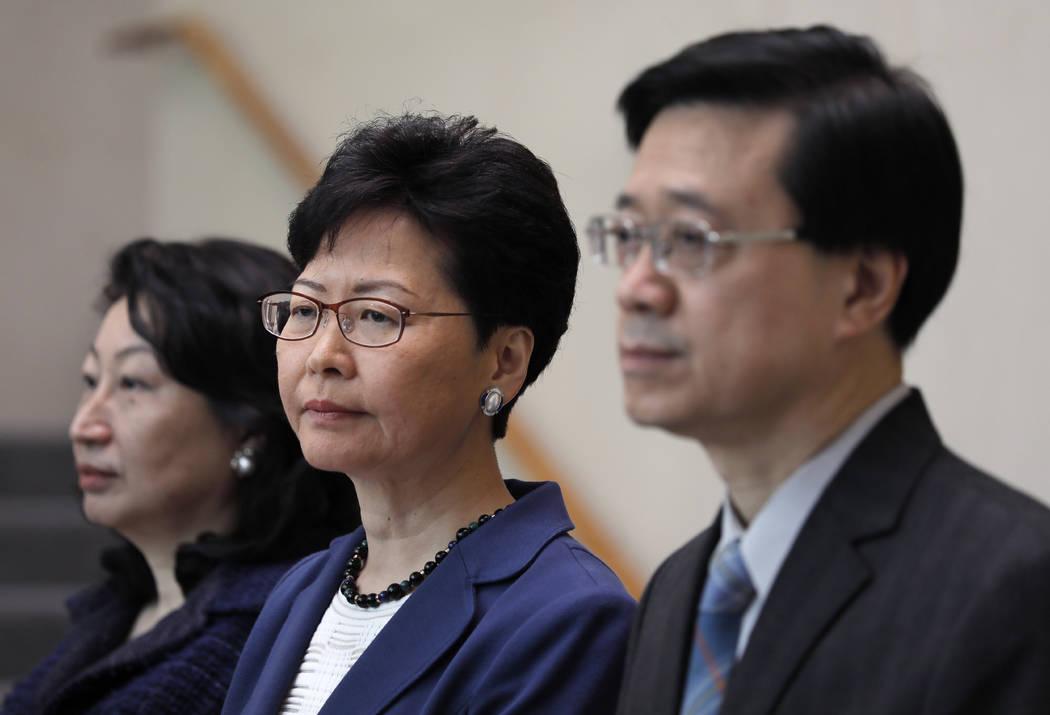 Hong Kong Secretary for Security John Lee, right, Hong Kong Chief Executive Carrie Lam, center ...