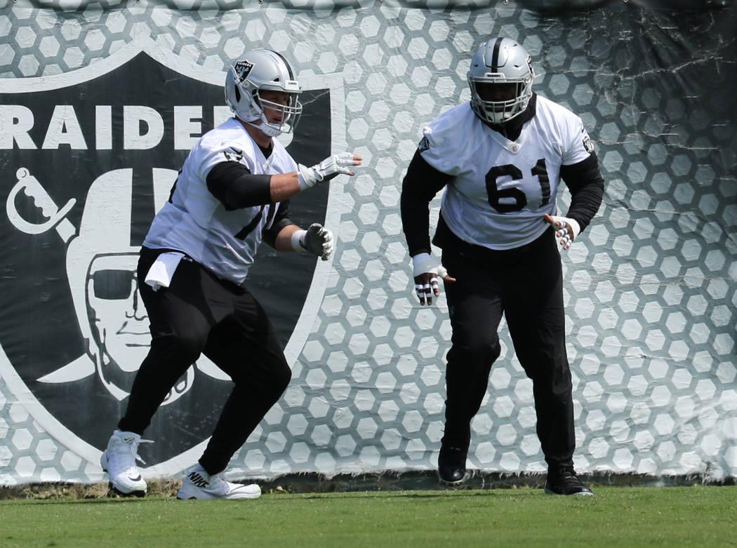 Oakland Raiders offensive guard Jordan Devey (70) and center Rodney Hudson (61) run through a d ...