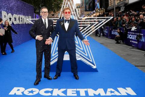 In this May 20, 2019, file photo, musician Elton John and his husband producer David Furnish, l ...