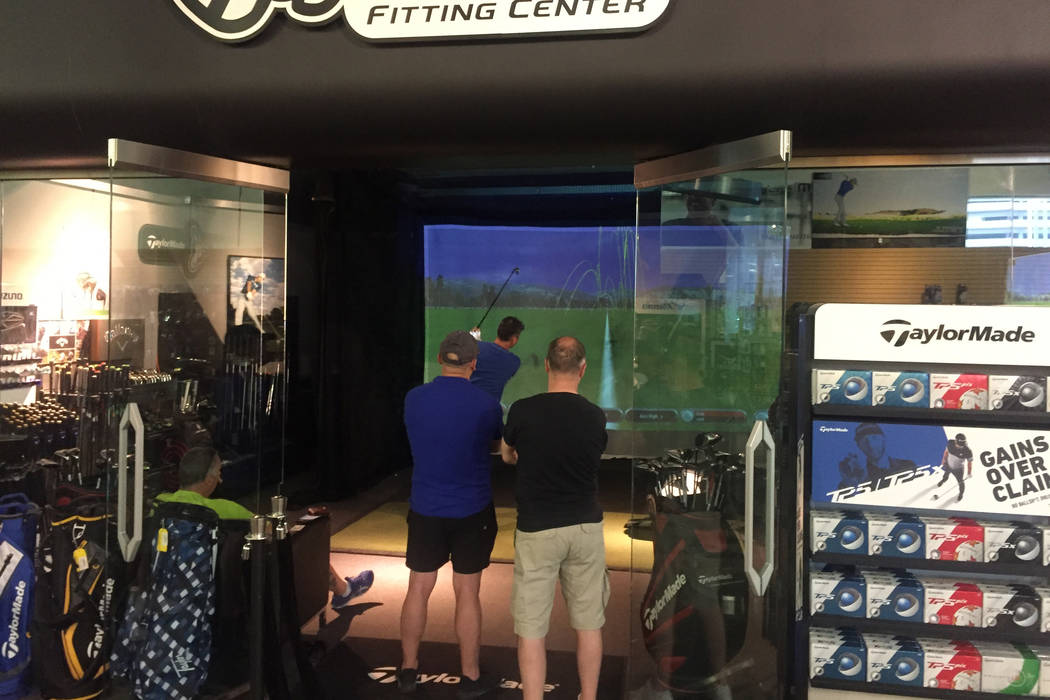 Golfers swing and observe in the state-of-the-art hitting bay at Las Vegas Golf Superstore, whi ...
