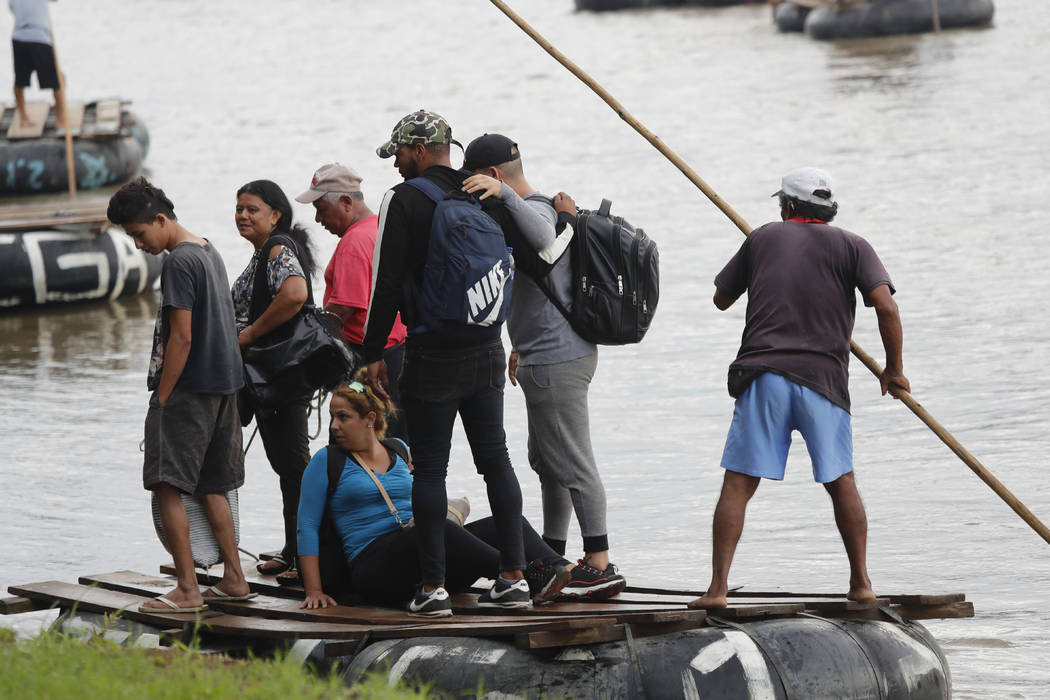 Cuban migrants land on the Mexican side of the Suchiate River on the border with Guatemala, aft ...