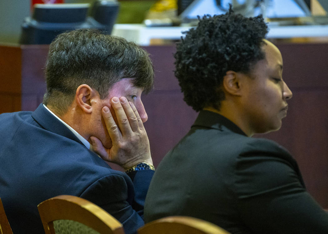 Dr. Mark Taylor listens to opening statements beside his lawyer Linda Rurangirwa during his tri ...