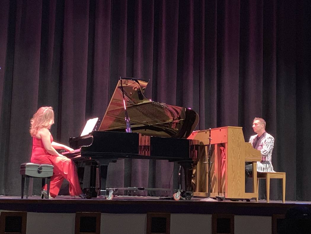 """Maria """"Masha"""" Pisarenko, left, performs a piano ballad with Dmytro Nehrych at the Summerlin ..."""