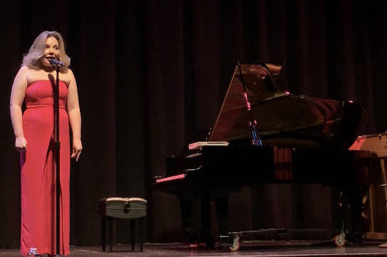 """Maria """"Masha"""" Pisarenko introduces one of the acts in the """"From Russia with Love"""" concert a ..."""