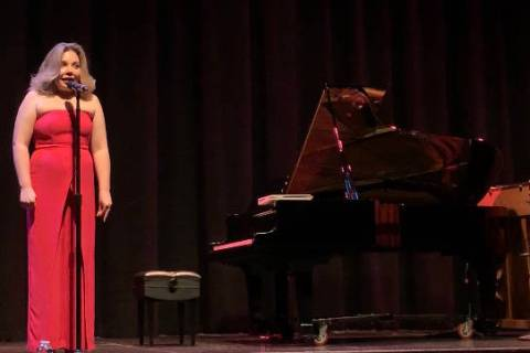 "Maria ""Masha"" Pisarenko introduces one of the acts in the ""From Russia with Love"" concert a ..."