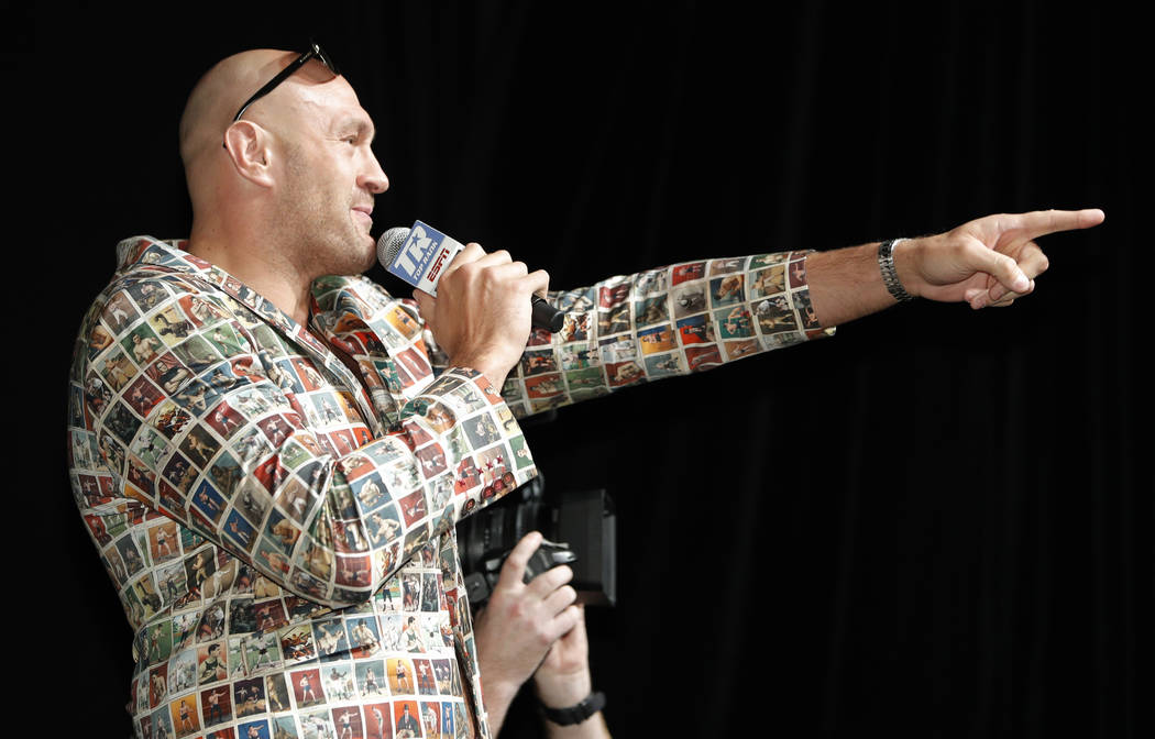 Tyson Fury, left, of England, speaks during a news conference, Wednesday, June 12, 2019, in Las ...