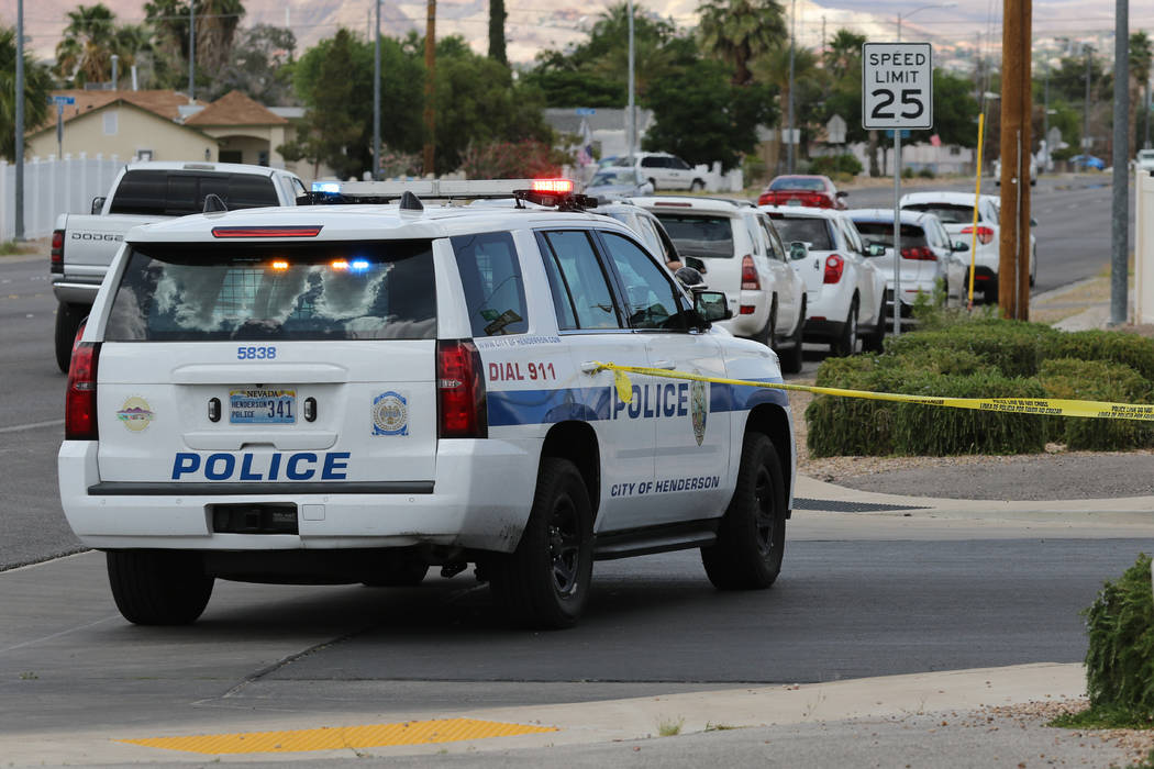 A police vehicle blocks the street near Van Wagenen St. and S. Major Ave., close to the scene o ...